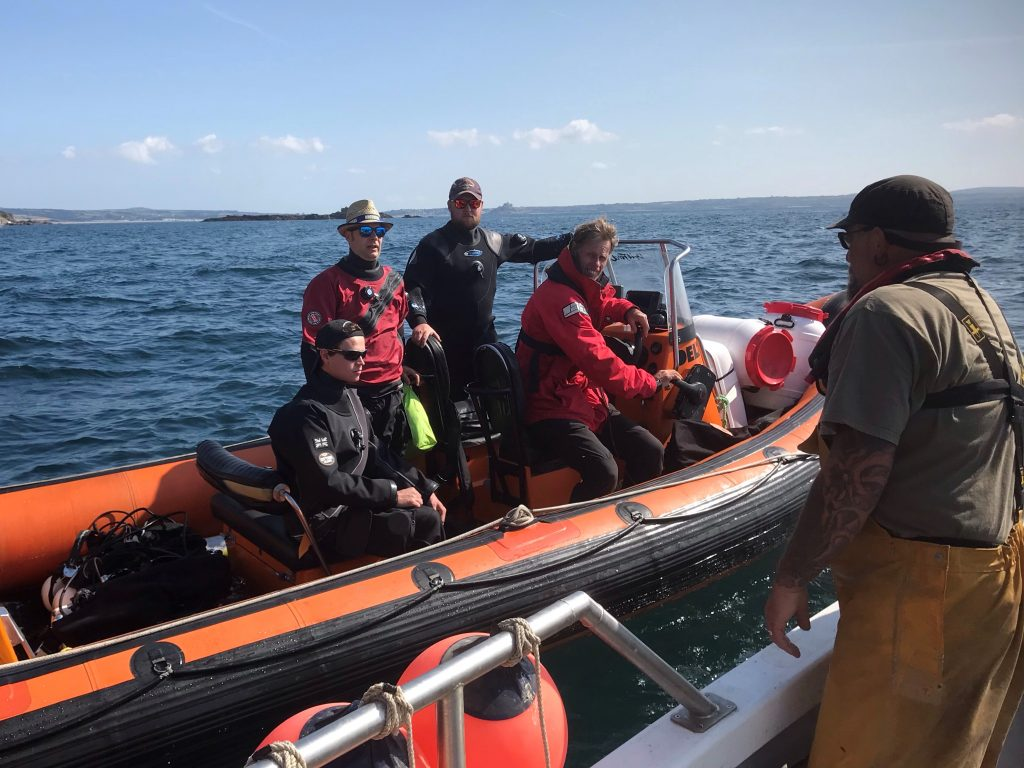 Ghost Fishing UK divers consulting fisherman